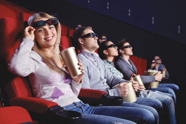 A group of people enjoying a movie with 3-D glasses in Edmonton
